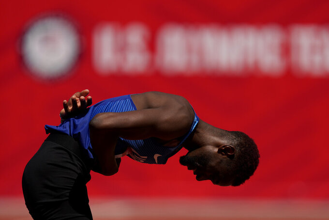 Shelby McEwen celebrates after the finals of the men's high jump at the U.S. Olympic Track and Field Trials Sunday, June 27, 2021, in Eugene, Ore. (AP Photo/Charlie Riedel)