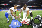 FILE - In this Sunday, Dec. 15, 2019 file photo, Detroit Lions wide receiver Kenny Golladay (19), left, and Tampa Bay Buccaneers linebacker Pat O'Connor (79) exchange jerseys after an NFL football game in Detroit.  NFL teams will be prohibited from postgame interactions within 6 feet of each other, so players won't be allowed to exchange jerseys after games as part of the guidelines to help limit the spread of the coronavirus.The restrictions are outlined in the game-day protocols finalized by the league and NFL Players Association on Wednesday, July 8, 2020.  (AP Photo/Paul Sancya, File)