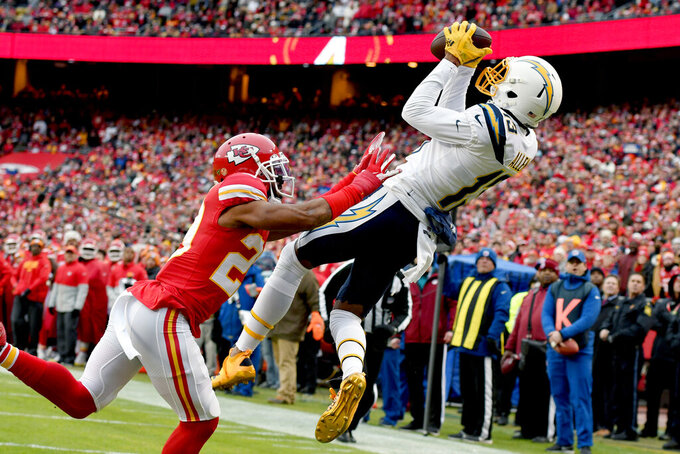 Los Angeles Chargers wide receiver Keenan Allen (13) makes a touchdown catch against Kansas City Chiefs cornerback Kendall Fuller (29) during the first half of an NFL football game in Kansas City, Mo., Sunday, Dec. 29, 2019. (AP Photo/Ed Zurga)