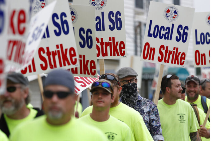 Striking shipbuilders picket outside an entrance to Bath Iron Works, Monday, June 22, 2020, in Bath, Maine. The vast majority of picketers did not wear pandemic facemarks. (AP Photo/Robert F. Bukaty)