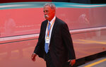 Formula One chairman Chase Carey walks in the paddock, at the Monza racetrack, in Monza, Italy, Thursday, Sept. 5, 2019. The Formula one GP will be held on Sunday. (AP Photo/Antonio Calanni)