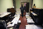 Volunteers try to save ancient music sheets by placing them to dry at the first floor of Venice Conservatory after recovering them from ground floor, Italy, Saturday, Nov. 16, 2019. High tidal waters returned to Venice on Saturday, four days after the city experienced its worst flooding in 50 years. Young Venetians are responding to the worst flood in their lifetimes by volunteering to help salvage manuscripts, clear out waterlogged books and lend a hand where needed throughout the stricken city. (AP Photo/Luca Bruno)