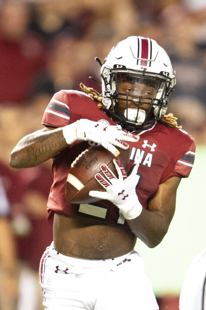 South Carolina running back MarShawn Lloyd runs with the ball in the first half of an NCAA college football game against Kentucky, Saturday, Sept. 25, 2021, at Williams-Brice Stadium in Columbia, S.C. (AP Photo/Hakim Wright Sr.)