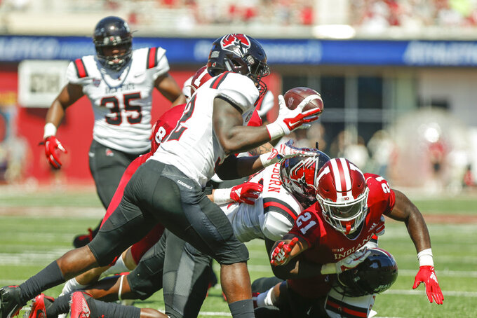 Ball State's Jeremiah Jackson (32) recovers a fumble by Indiana's Stevie Scott (21) during an NCAA college football game, Saturday, Sept. 15, 2018 in Bloomington, Ind.(Jeremy Hogan/The Herald-Times via AP)