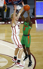 Florida A&M's Kamron Reeves (2) is defended by Oklahoma's Brady Manek (35) during the second half of an NCAA college basketball game in Norman, Okla., Saturday, Dec. 12, 2020. (AP Photo/Garett Fisbeck)