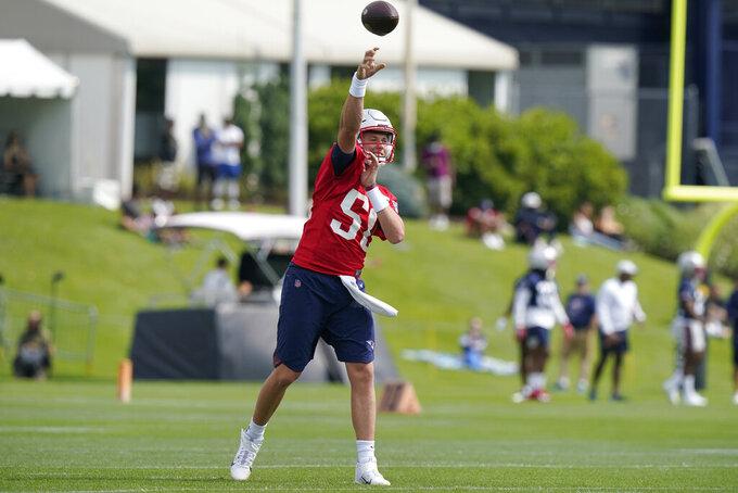 New England Patriots quarterback Mac Jones passes the ball during an NFL football practice, Thursday, July 29, 2021, in Foxborough, Mass. (AP Photo/Steven Senne)