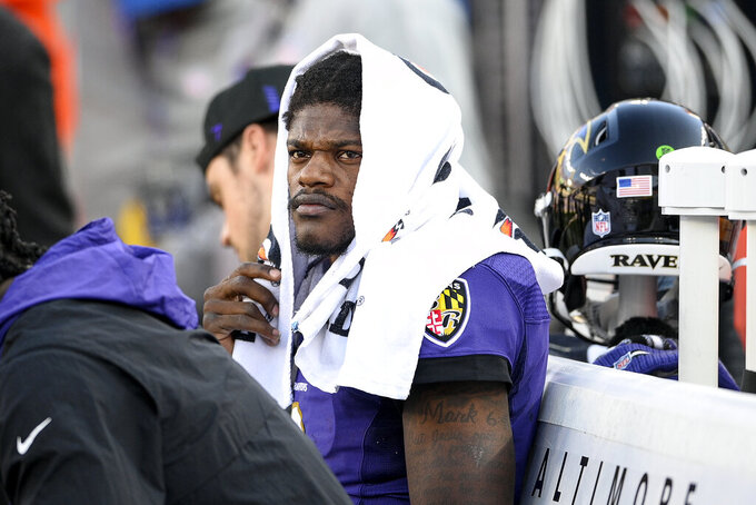 Baltimore Ravens quarterback Lamar Jackson sits on the bench during the second half of an NFL football game against the Cincinnati Bengals, Sunday, Oct. 24, 2021, in Baltimore. The Bengals won 41-17. (AP Photo/Nick Wass)