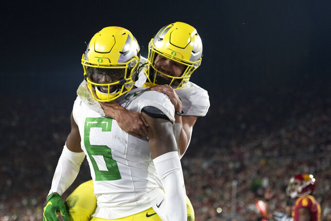 Herbert leads No. 7 Ducks past USC 56-24 to 8th straight win