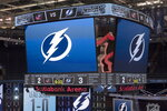 The scoreboard is shown after the Tampa Bay Lightning defeated the Columbus Blue Jackets in five overtimes in Game 1 of an NHL hockey Stanley Cup first-round playoff series, Tuesday, Aug. 11, 2020, in Toronto. (Frank Gunn/The Canadian Press via AP)