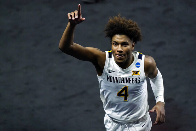 West Virginia's Miles McBride waves to the crowd as he leaves the court following a win over Morehead State in a college basketball game in the first round of the NCAA tournament at Lucas Oil Stadium Saturday, March 20, 2021, in Indianapolis. (AP Photo/Mark Humphrey)
