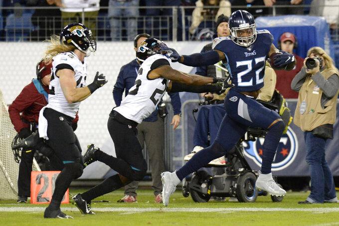 Tennessee Titans running back Derrick Henry (22) runs past Jacksonville Jaguars safety Jarrod Wilson (26) as Henry scores a touchdown on a 74-yard run in the second half of an NFL football game Sunday, Nov. 24, 2019, in Nashville, Tenn. (AP Photo/Mark Zaleski)