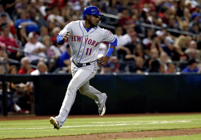 New York Mets' Adeiny Hechavarria scores on a base hit by teammate Carlos Gomez during the eighth inning of a baseball game against the Arizona Diamondbacks, Friday, May 31, 2019, in Phoenix. (AP Photo/Matt York)