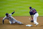 Houston Astros' Michael Brantley steals second with Washington Nationals' Asdrubal Cabrera covering during the third inning of Game 3 of the baseball World Series Friday, Oct. 25, 2019, in Washington. (AP Photo/Alex Brandon)