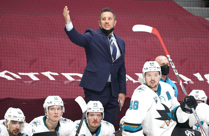 San Jose Sharks head coach Bob Boughner waves goaltender Martin Jones off the ice late in the third period of an NHL hockey game against the Colorado Avalanche, Friday, April 30, 2021, in Denver. (AP Photo/David Zalubowski)
