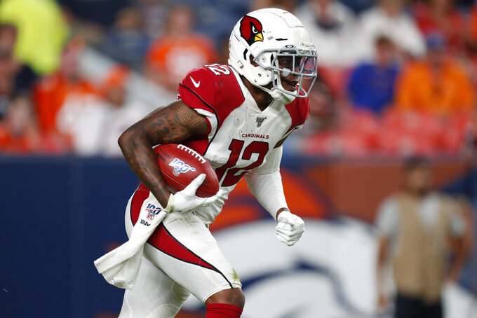 Arizona Cardinals wide receiver Pharoh Cooper (12) runs the ball against the Denver Broncos during the second half of an NFL preseason football game, Thursday, Aug. 29, 2019, in Denver. (AP Photo/David Zalubowski)