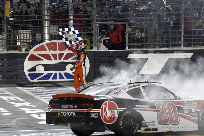 Christopher Bell celebrates his win in the NASCAR Xfinity Series auto race at Texas Motor Speedway in Fort Worth, Texas, Saturday, Nov. 2, 2019. (AP Photo/Randy Holt)