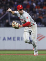 Philadelphia Phillies second baseman Scott Kingery throws out San Francisco Giants' Brandon Crawford at first base during the fourth inning of a baseball game in San Francisco, Thursday, Aug. 8, 2019. (AP Photo/Jeff Chiu)