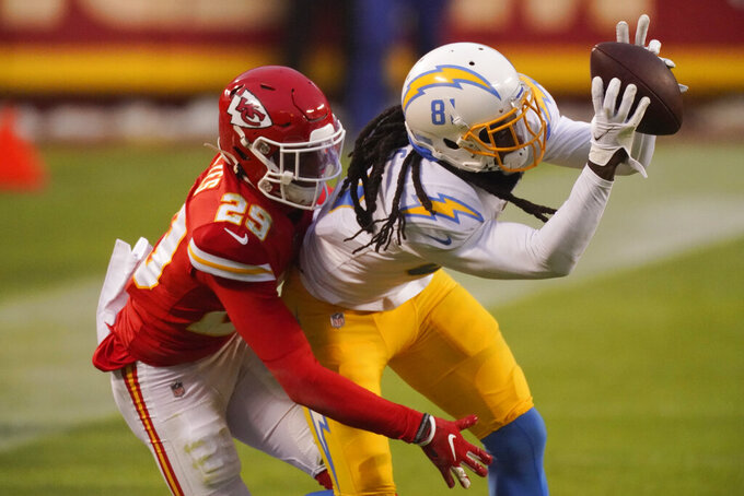 Los Angeles Chargers wide receiver Mike Williams catches a pass in front of Kansas City Chiefs cornerback Bopete Keyes, left, during the first half of an NFL football game, Sunday, Jan. 3, 2021, in Kansas City. (AP Photo/Charlie Riedel)