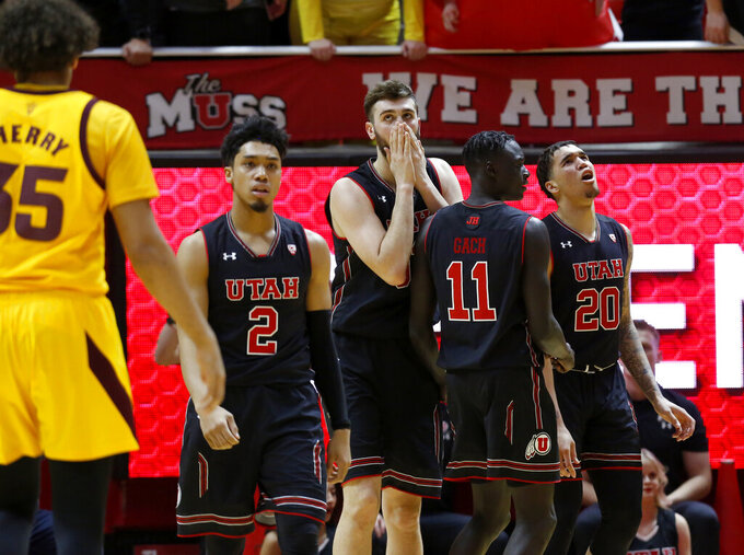 Utah players react to a foul being called on their team late in the second half of an NCAA college basketball game against Arizona State on Saturday, Feb. 16, 2019, in Salt Lake City. Arizona State won 98-87. (AP Photo/Kim Raff)
