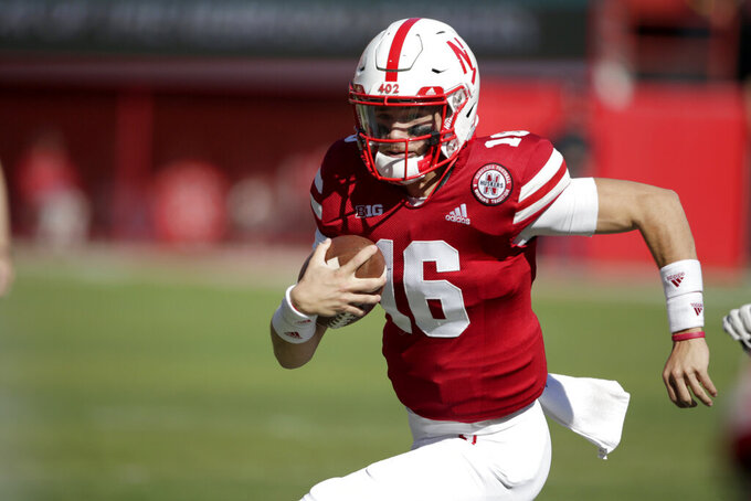 FILE - In this Oct. 27, 2018 file photo, Nebraska quarterback Noah Vedral (16) scrambles during the second half of an NCAA college football game against Bethune-Cookman in Lincoln, Neb. Nebraska quarterback Noah Vedral has entered the transfer portal and plans to play his final two seasons at another school, an athletic department spokesman confirmed Tuesday, April 28, 2020. (AP Photo/Nati Harnik, file)