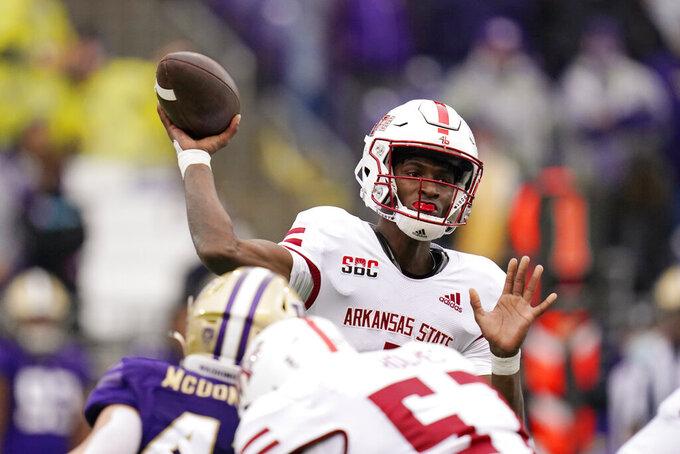 Arkansas State quarterback James Blackman throws against Washington in the second half of an NCAA college football game, Saturday, Sept. 18, 2021, in Seattle. Washington won 52-3. (AP Photo/Elaine Thompson)