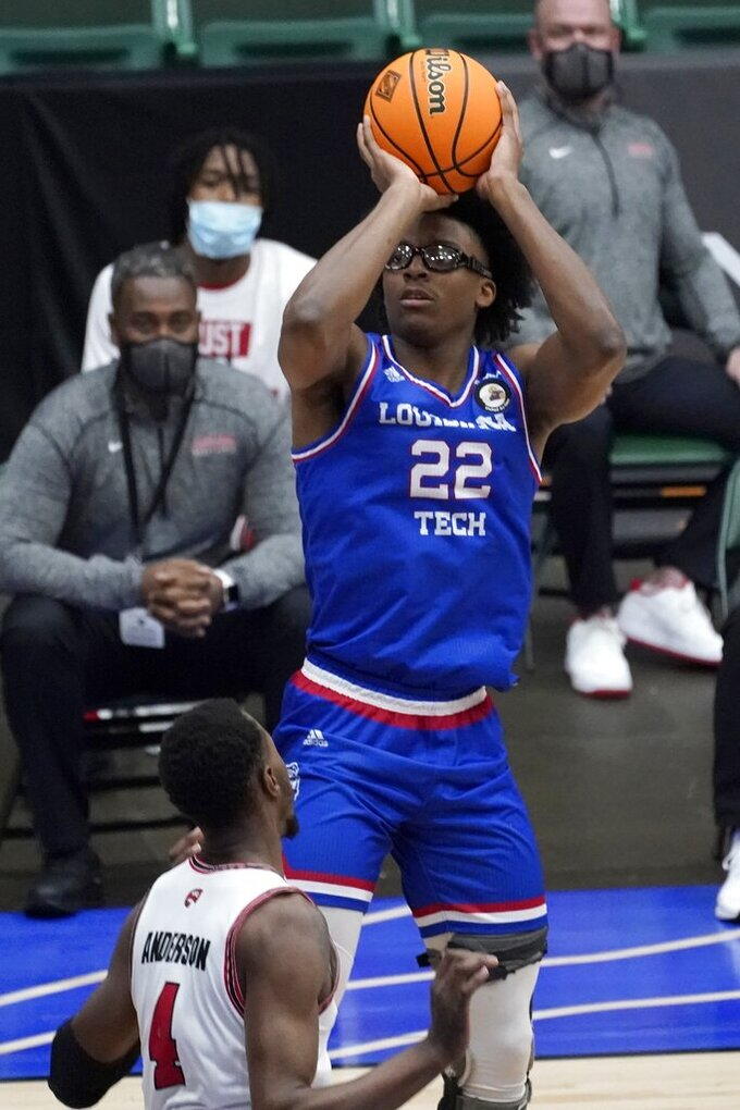 Louisiana Tech forward Isaiah Crawford (22) attempts to shoot over Western Kentucky guard Josh Anderson (4) in the first half of an NCAA college basketball game in the quarterfinals of the NIT, Thursday, March 25, 2021, in Frisco, Texas. (AP Photo/Tony Gutierrez)