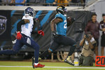 Jacksonville Jaguars running back Leonard Fournette, right, runs away from Tennessee Titans free safety Kevin Byard for a 69-yard gain during the second half of an NFL football game, Thursday, Sept. 19, 2019, in Jacksonville, Fla. (AP Photo/Stephen B. Morton)