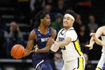 North Florida forward 2, left, looks to pass around Iowa forward Cordell Pemsl during the first half of an NCAA college basketball game, Thursday, Nov. 21, 2019, in Iowa City, Iowa. (AP Photo/Charlie Neibergall)