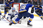 St. Louis Blues' Mackenzie MacEachern (28) is unable to score past Tampa Bay Lightning goaltender Andrei Vasilevskiy (88), of Russia, during the second period of an NHL hockey game Tuesday, Nov. 19, 2019, in St. Louis. (AP Photo/Jeff Roberson)