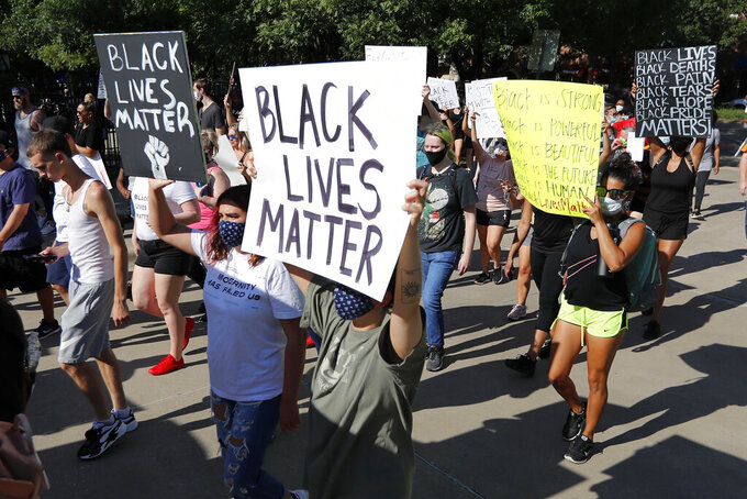 Several hundred demonstrators march peacefully as they protest in Addison, Texas, Thursday, June 4, 2020. Protests continued following the death of George Floyd, who died after being restrained by Minneapolis police officers on May 25. (AP Photo/Tony Gutierrez)