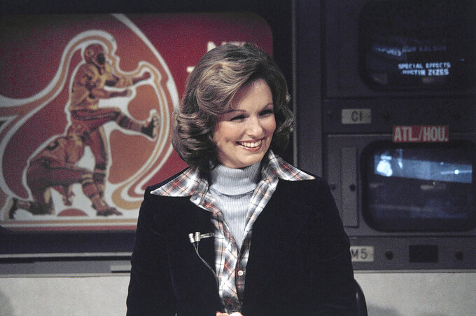 "FILE - In this Nov. 28, 1976 file photo, CBS sportscaster Phyllis George is seen in New York. Phyllis George, the former Miss America who became a female sportscasting pioneer on CBS's ""The NFL Today"" and served as the first lady of Kentucky, has died. She was 70. A family spokeswoman said George died Thursday, May 14, 2020, at a Lexington hospital after a long fight with a blood disorder.(AP Photo/Suzanne Vlamis, File)"