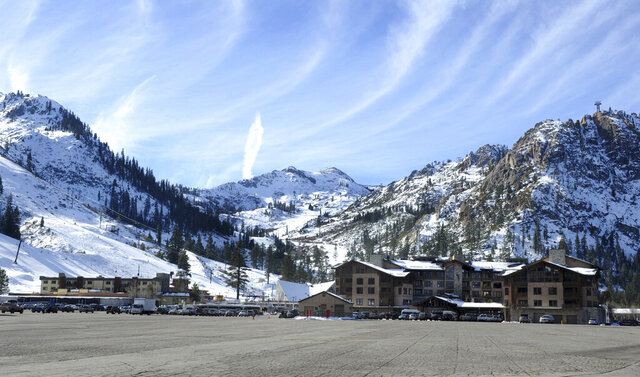 FILE - In this Dec. 16, 2011, file photo the base village at Squaw Valley in Olympic Valley, Calif., is seen. Conservationists at Lake Tahoe have agreed to drop a lawsuit challenging plans to build a 2-mile-long gondola connecting two ski resorts in exchange for neighboring land purchases and other wildlife protection measures. The resorts, including one that hosted the 1960 Winter Olympics, and a wilderness protection group finalized the agreement this week as part of the U.S. Forest Service's final approval of the gondola that will skirt federally protected wilderness that is home to an endangered frog. (Tim Dunn/The Reno Gazette-Journal via AP,File)
