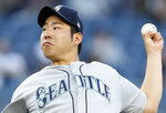 In this Wednesday, May 8, 2019, photo, Seattle Mariners starting pitcher Yusei Kikuchi winds up during the team's baseball game against the New York Yankees in New York. A day after a dark substance was spotted under the bill of Kikuchi's cap in a win at Yankee Stadium — possibly illegal pine tar — all sides kept cool. MLB issued no penalty or even a statement on the matter Thursday.