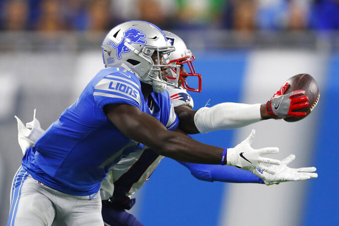 New England Patriots defensive back J.C. Jackson reaches for the pass intended for Detroit Lions wide receiver Andy Jones during the first half of a preseason NFL football game Thursday, Aug. 8, 2019, in Detroit. (AP Photo/Paul Sancya)