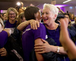 Independent candidate Kerryn Phelps, right, is congratulated by supporters as she arrives for a Wentworth by-election evening function at North Bondi Life Saving Club in Sydney, Saturday, Oct. 20, 2018. Australia's ruling coalition will be forced into minority government after a heavy defeat in a by-election for former Liberal Party Prime Minister Malcolm Turnbull's old seat. With 15 percent of votes counted Saturday, Liberal candidate Dave Sharma conceded defeat to Phelps. (Chris Pavlich/AAP Image via AP)