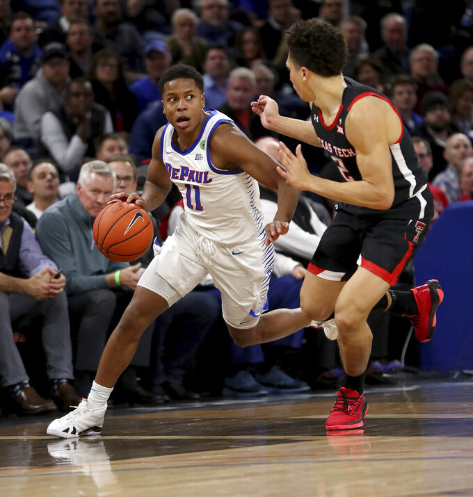 DePaul guard Charlie Moore (11) is defended by Texas Tech's Clarence Nadolny during the first half of an NCAA college basketball game in Chicago on Wednesday, Dec. 4, 2019. (Chris Sweda/Chicago Tribune via AP)