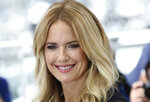 """FILE - In this May 15, 2018, file photo, actress Kelly Preston poses for photographers during a photo call for the film 'Gotti' at the 71st international film festival, Cannes, southern France.  Actress Kelly Preston, whose credits included the films """"Twins"""" and """"Jerry Maguire,"""" died Sunday, July 12, 2020, her husband John Travolta said. She was 57. (Photo by Joel C Ryan/Invision/AP, File)"""
