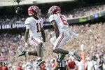 Alabama wide receiver Henry Ruggs III (11) and wide receiver DeVonta Smith (6) react after Ruggs' 33-yard catch and run touchdown against Texas A&M during the third quarter of an NCAA college football game, Saturday, Oct. 12, 2019, in College Station, Texas. (AP Photo/Sam Craft)