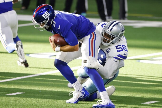 New York Giants quarterback Daniel Jones (8) is sacked by Dallas Cowboys defensive end Aldon Smith (58) in the second half of an NFL football game in Arlington, Texas, Sunday, Oct. 11, 2020. (AP Photo/Ron Jenkins)