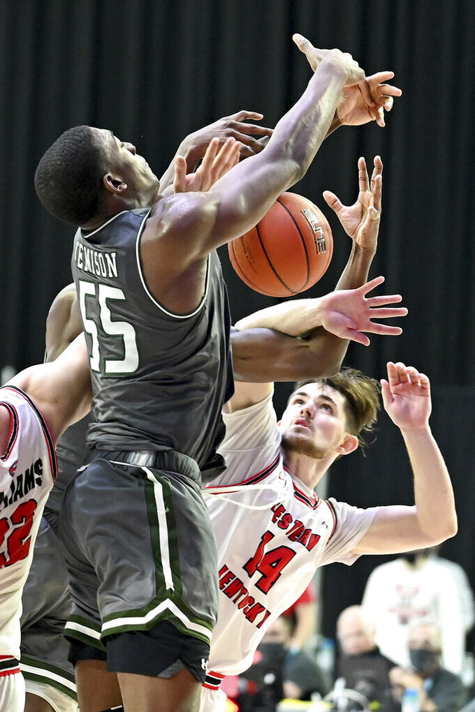 Western Kentucky forward Carson Williams (22), UAB center Trey Jemison (55) and Western Kentucky guard Luke Frampton (14) go after a rebound in the second half of an NCAA college basketball game in the Conference USA men's tournament in Frisco, Texas, Friday, March 12, 2021. Western Kentucky won 64-60. (AP Photo/Matt Strasen)