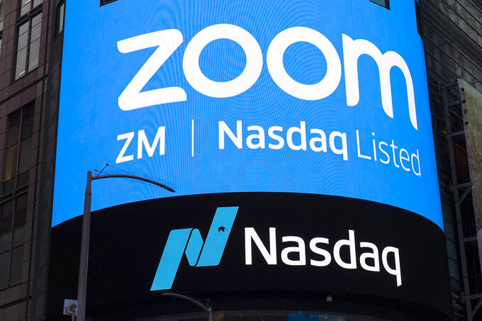 FILE - This April 18, 2019, file photo shows a sign for Zoom Video Communications ahead of their Nasdaq IPO in New York. Zoom is still booming, raising prospects that the video-conferencing service will be able to sustain its momentum, even as the easing pandemic lessens the need for virtual meetings. Some signs for optimism emerged in the company's latest quarterly earnings report released Tuesday, June 1, 2021, fueling a modest rally in the company's recently slumping stock. (AP Photo/Mark Lennihan, File)