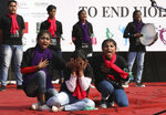 Children enact a play on awareness on violence against women and children during the