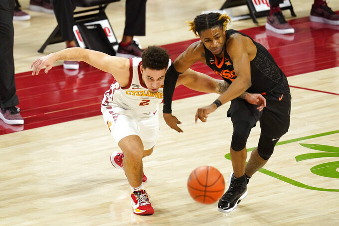 Oklahoma State guard Rondel Walker, right, steals the ball from Iowa State guard Nate Jenkins during the second half of an NCAA college basketball game, Monday, Jan. 25, 2021, in Ames, Iowa. Oklahoma State won 81-60. (AP Photo/Charlie Neibergall)