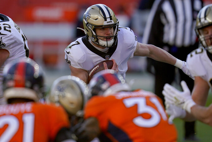 New Orleans Saints quarterback Taysom Hill (7) scrambles against the Denver Broncos during the first half of an NFL football game, Sunday, Nov. 29, 2020, in Denver. (AP Photo/David Zalubowski)