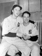 FILE - In this Oct. 4, 1936, file photo, winning pitcher Monte Pearson, left, and Lou Gehrig celebrate after Game 4 of the World Series against the New York Giants, in New York. The Yankees went on to win the series 4 games to 2. (AP Photo/File)