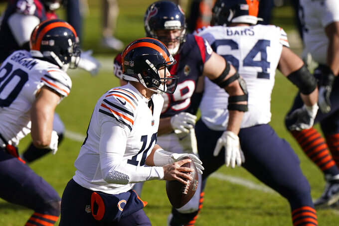 Chicago Bears quarterback Mitchell Trubisky (10) looks to throw during the first half of an NFL football game against the Houston Texans, Sunday, Dec. 13, 2020, in Chicago. (AP Photo/Nam Y. Huh)