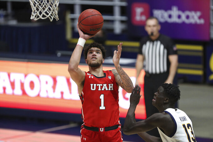 Utah forward Timmy Allen (1) shoots against California forward Kuany Kuany during the first half of an NCAA college basketball game in Berkeley, Calif., Thursday, Feb. 11, 2021. (AP Photo/Jed Jacobsohn)