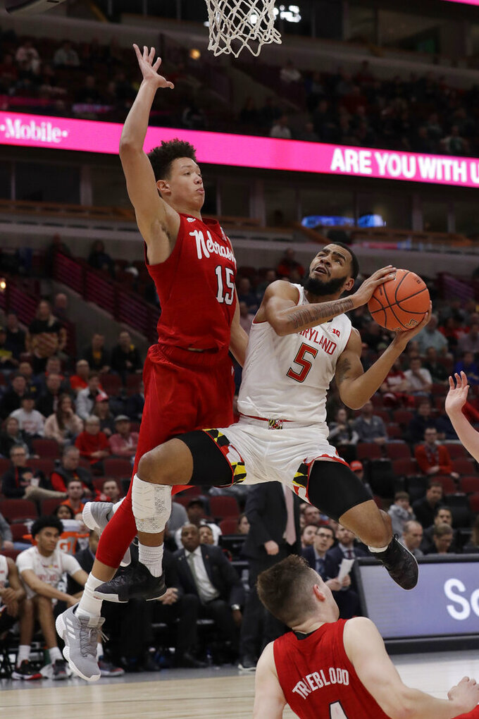 Maryland's Eric Ayala (5) shoots against Nebraska's Isaiah Roby (15) during the second half of an NCAA college basketball game in the second round of the Big Ten Conference tournament, Thursday, March 14, 2019, in Chicago. The Nebraska won 69-61. (AP Photo/Nam Y. Huh)