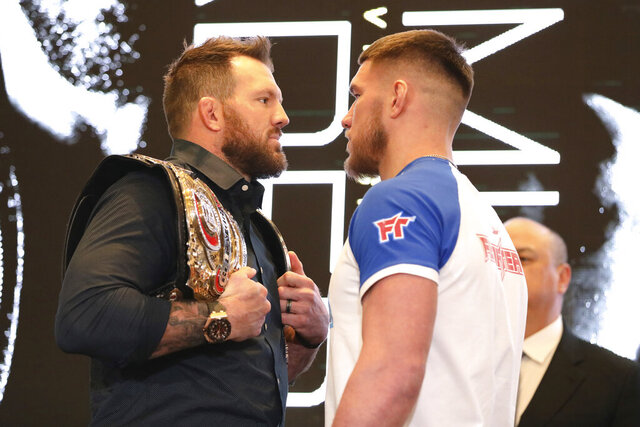 In this March 9, 2020, photo, Ryan Bader, left, squares off with Vadim Nemkov at a news conference promoting the Bellator Spring & Summer fight cards in New York City. Bellator is still hopeful of running its next mixed martial arts card on May 9. That event could be in jeopardy after President Donald Trump extended federal guidelines recommending people stay home for another 30 days until the end of April to prevent the spread of the new coronavirus. (AP Photo/Gregory Payan)