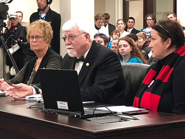 Kentucky state Rep. Danny Bentley (center) presents a bill to a House committee on Thursday, Feb. 13, 2020, in Frankfort, Ky. His bill would cap the out-of-pocket costs for many Kentuckians to purchase insulin.  (AP Photo/Bruce Schreiner)